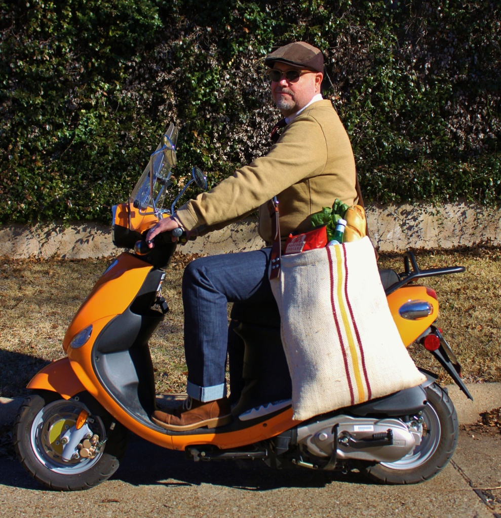 Jamie on the Scooter with the Grain Sack Grocery Bag