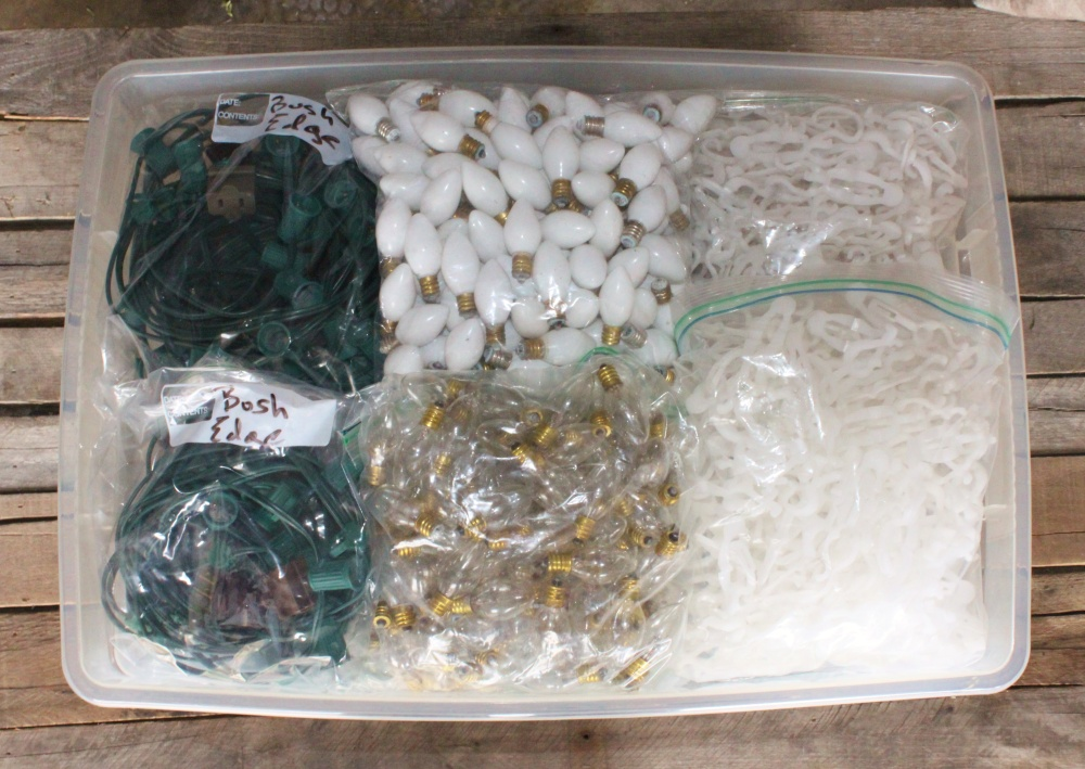 Tub full of Bulbs, Cords and Clips in Labled Bags
