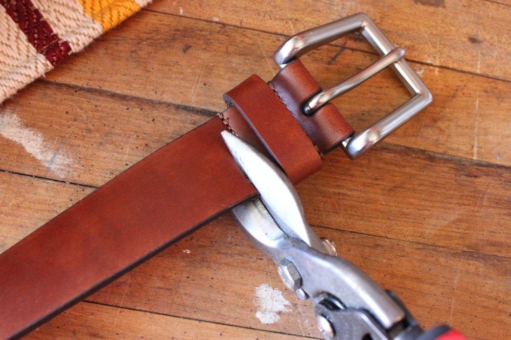 Use Tin Snips to Cut through the Leather Belt