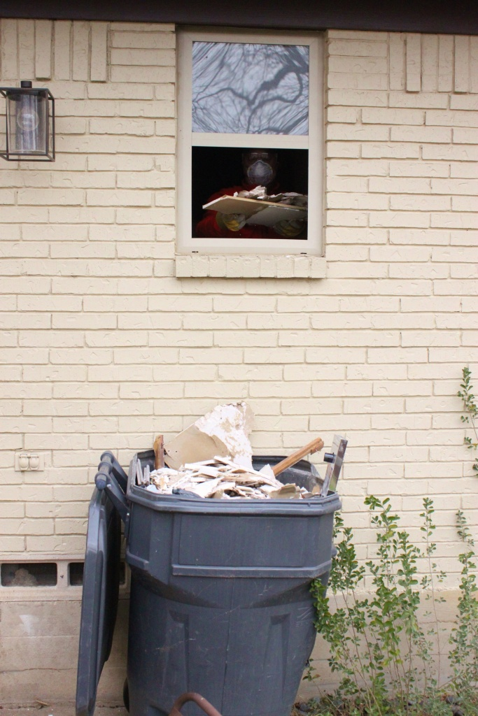 Trash Can Under the Bathroom Window