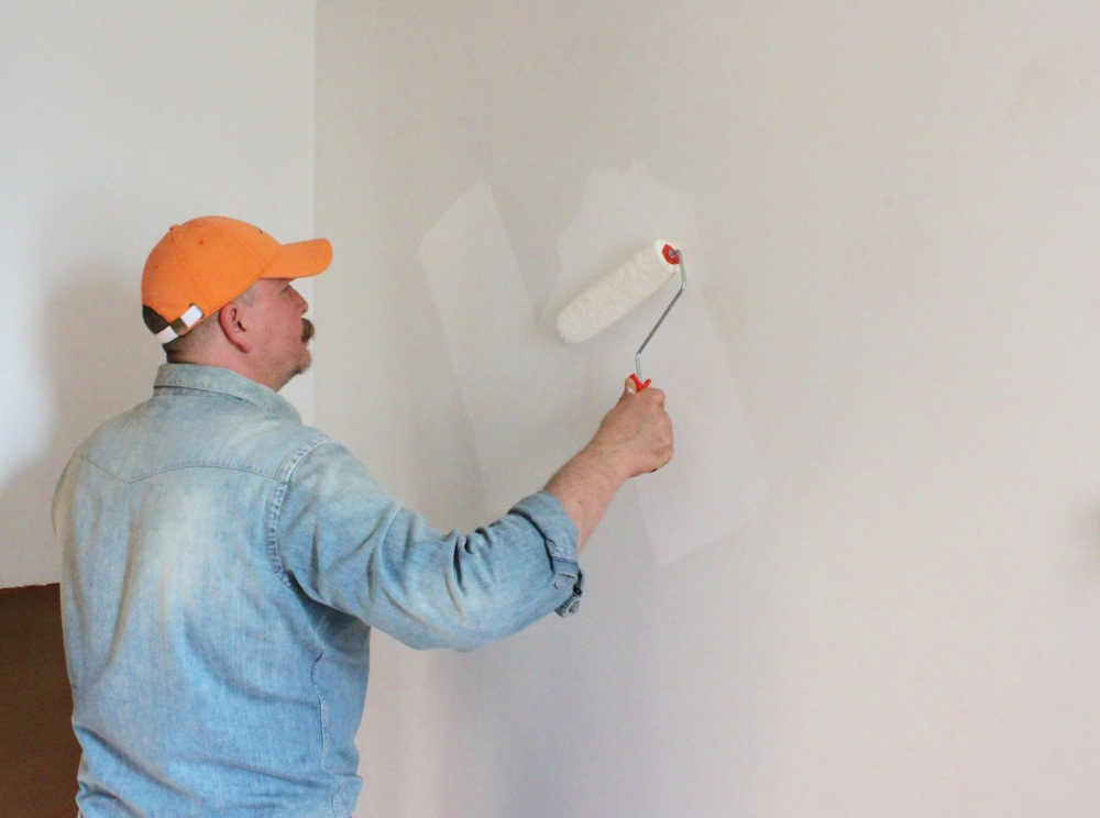 James Painting Brilliant White on the Master Bathroom Walls