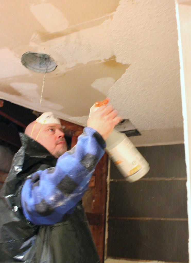 Jamie Spraying the Popcorn off the MAster Bathroom Ceiling