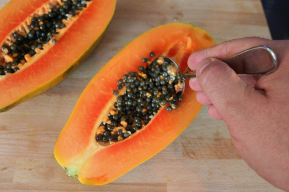 Use a Spoon to Scoop Out the Papaya Seeds