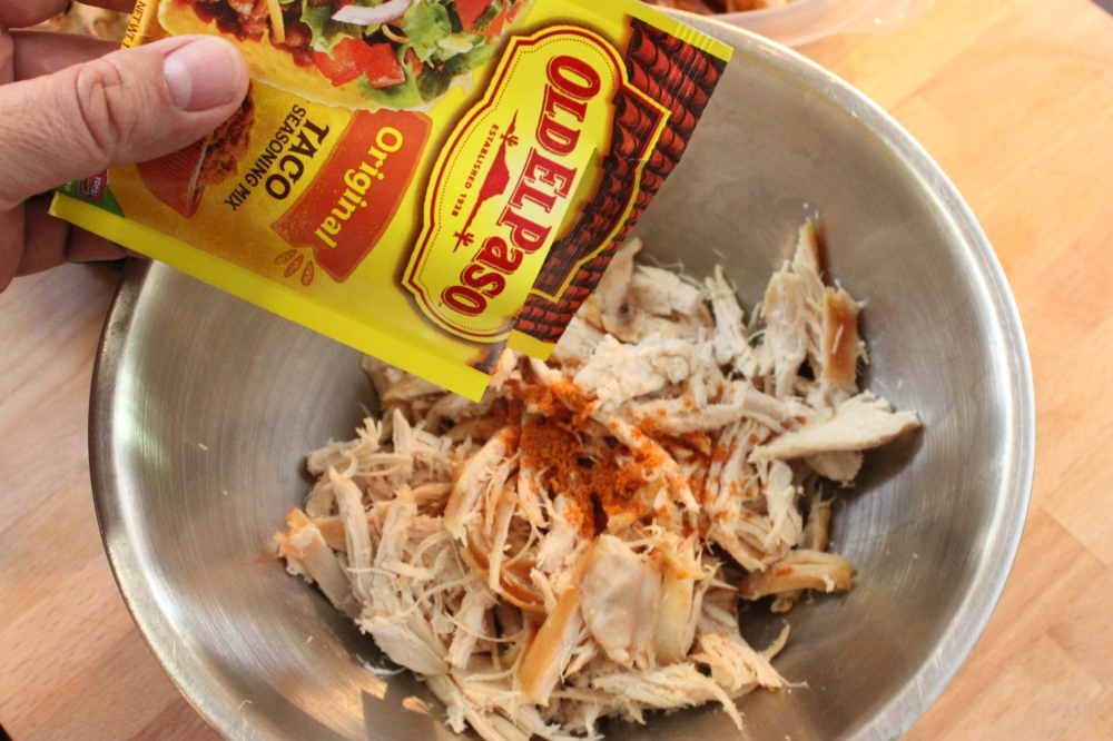 Toss a Few Teaspoons of Taco Seasoning with the Shreaded Chicken