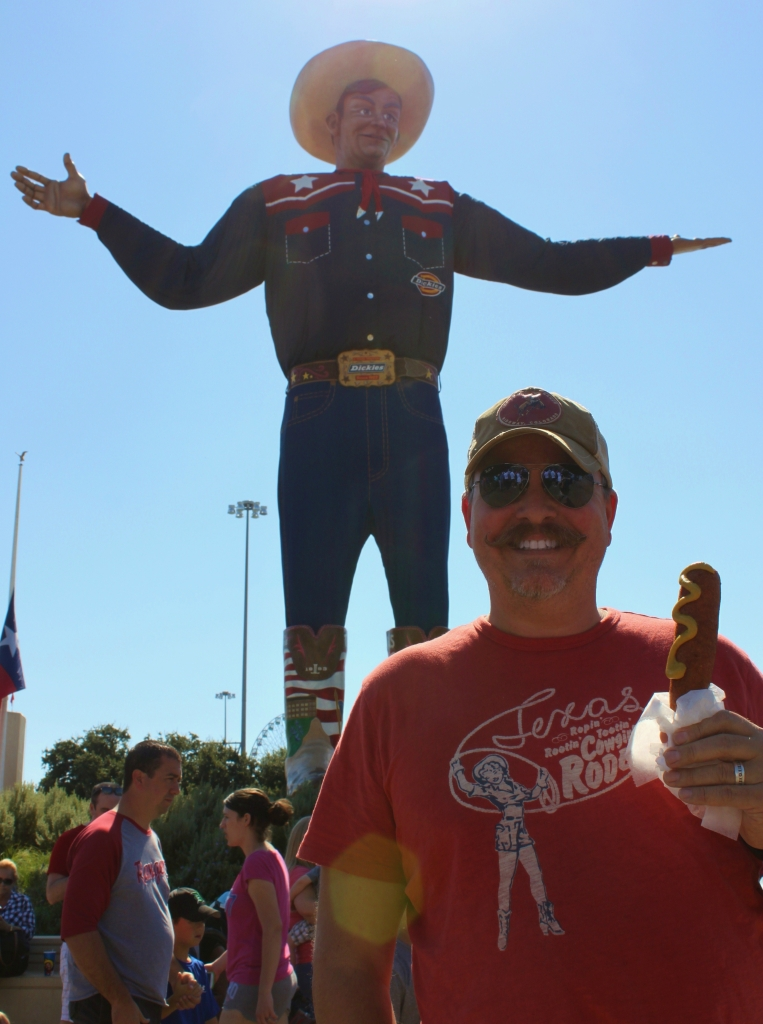James and His Corny Dog in Front of Big Tex