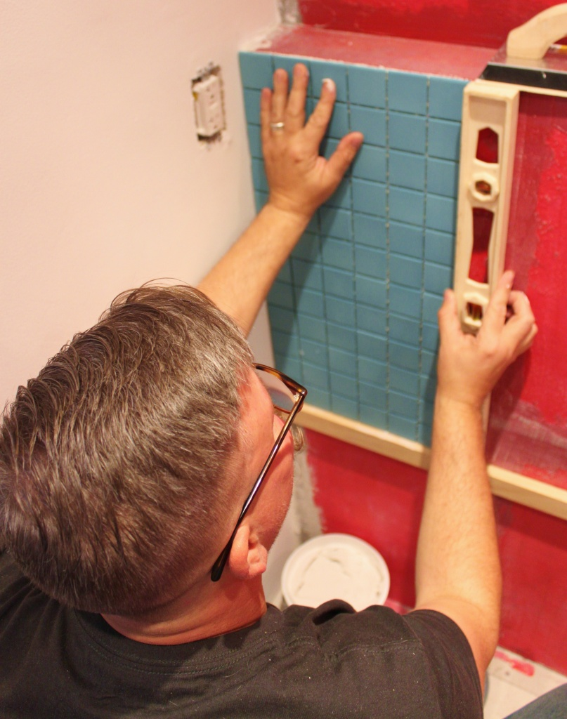 James Making Sure that Frist Piece of Tile is Level