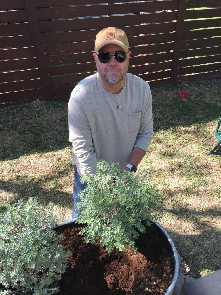 Jamie Planting Desert Sage in the Horse Troughs