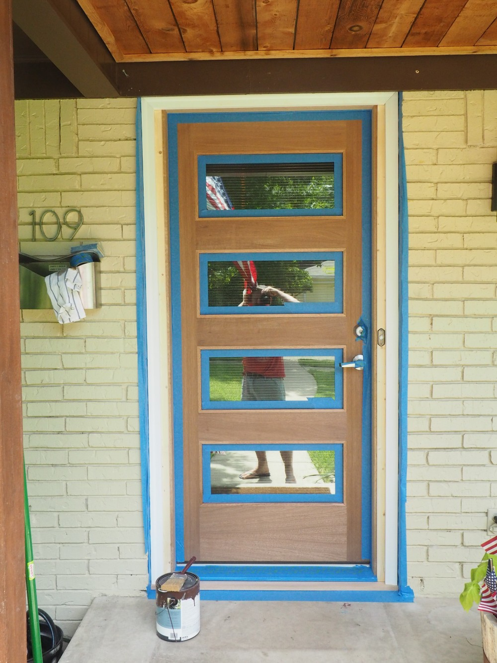 Modern Door with Blue Tape on Trim