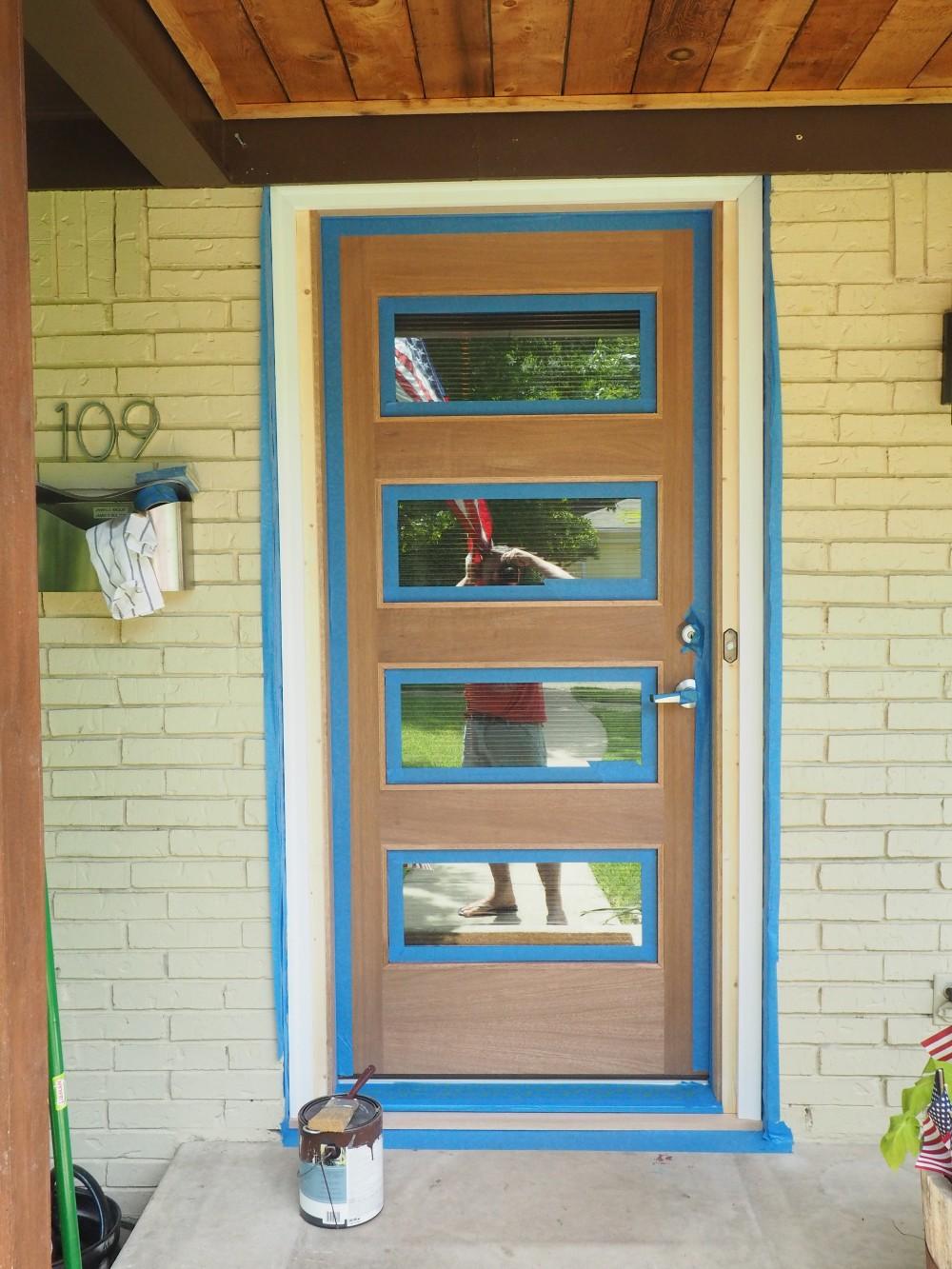 Modern Door with Blue Tape on Trim