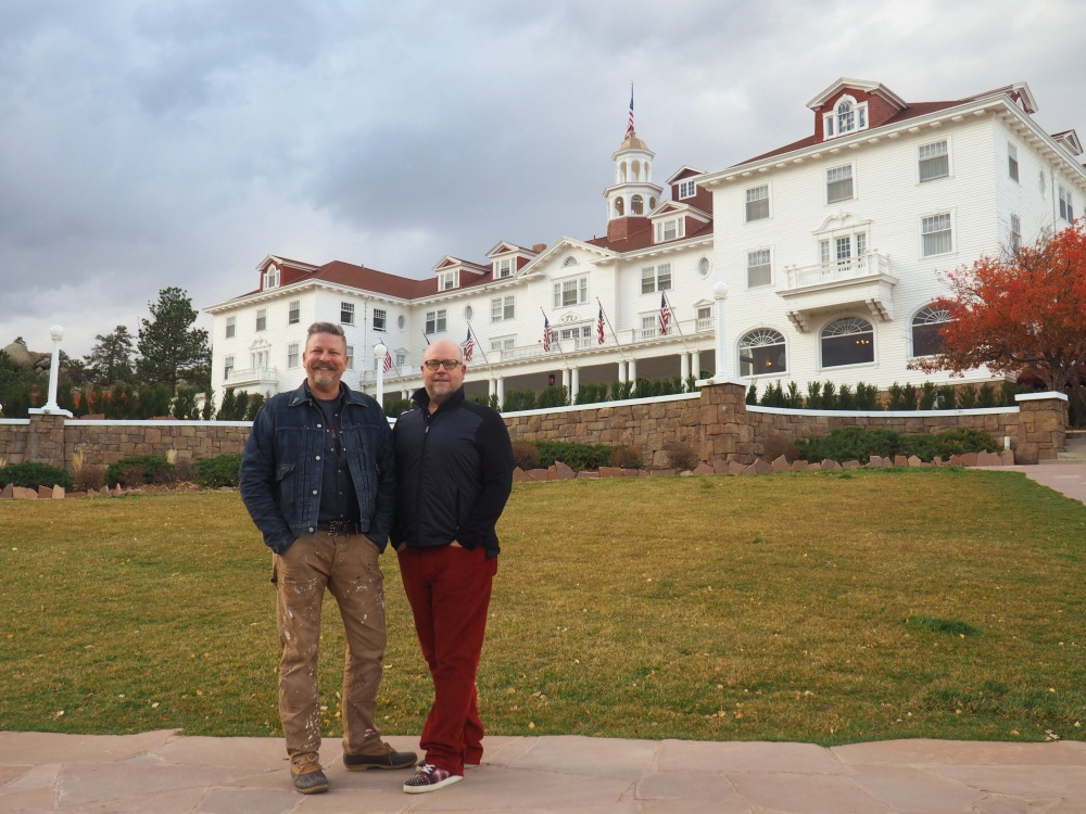 james-and-jamie-in-front-of-the-stanley-hotel