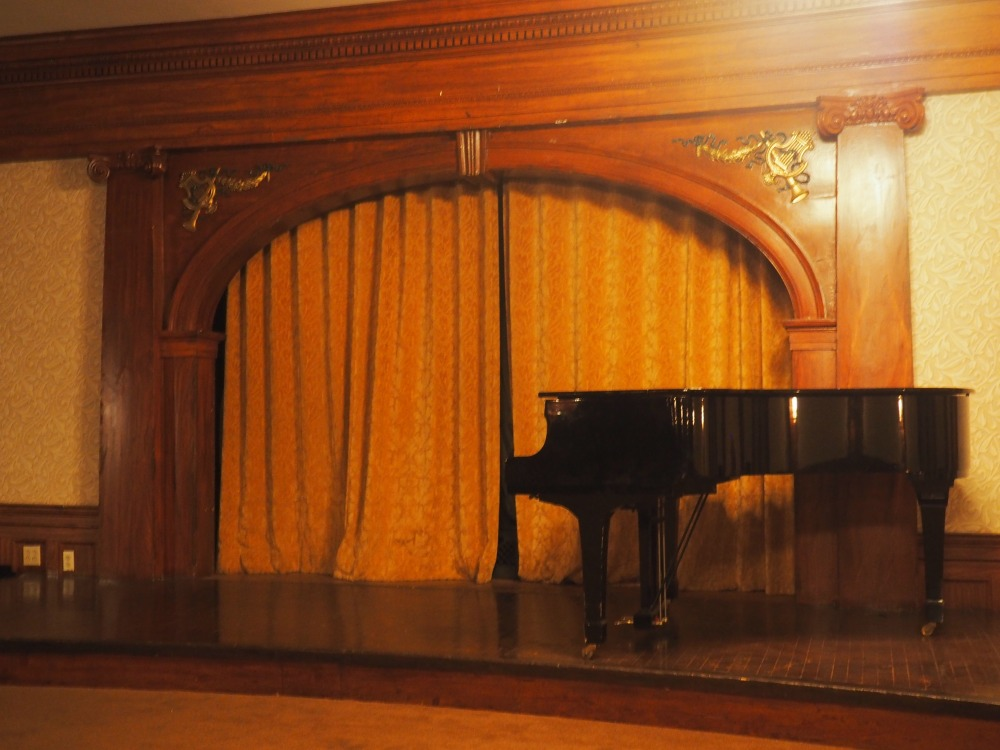 piano-and-stage-in-the-grand-ballroom-of-the-stanley-hotel