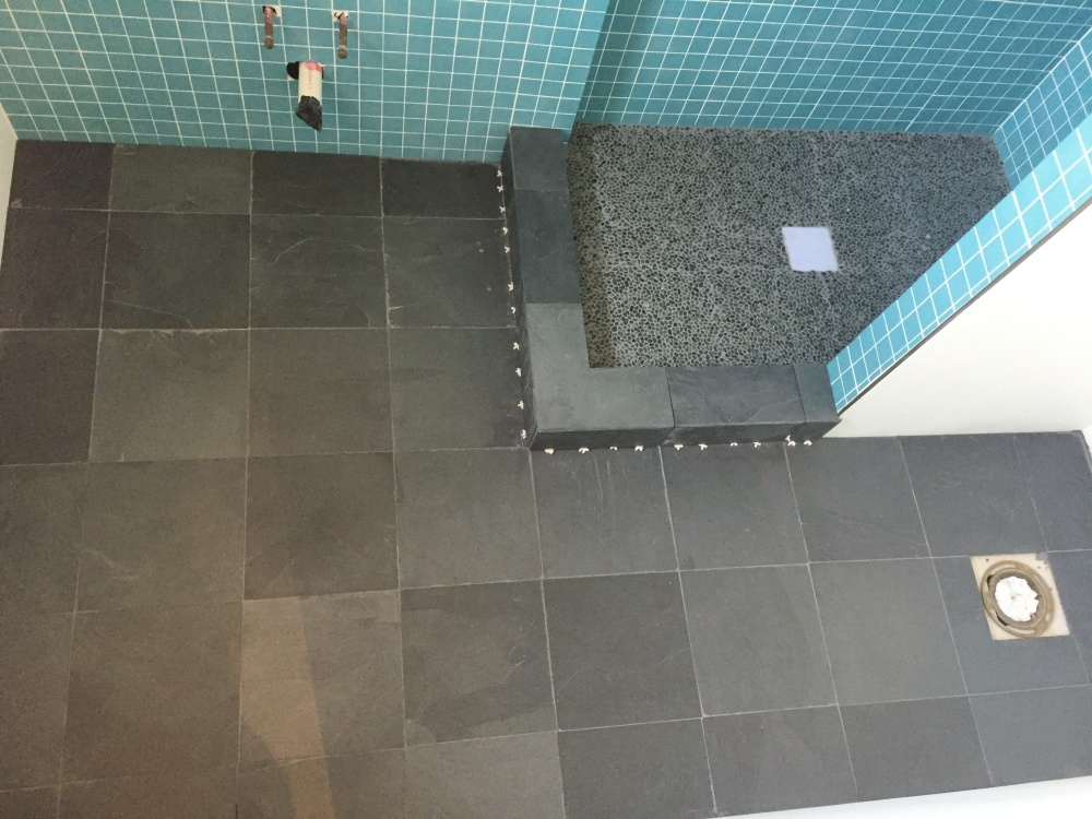 slate-floor-and-shower-edge-in-the-master-bathroom