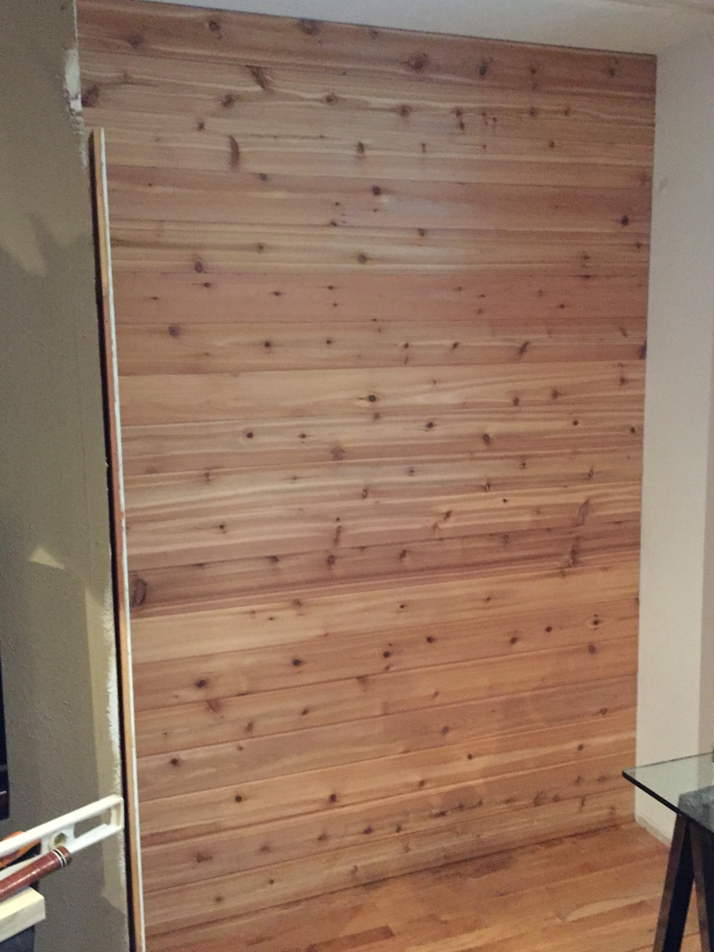 Finished Cedar Wall in the Master Bedroom Closet