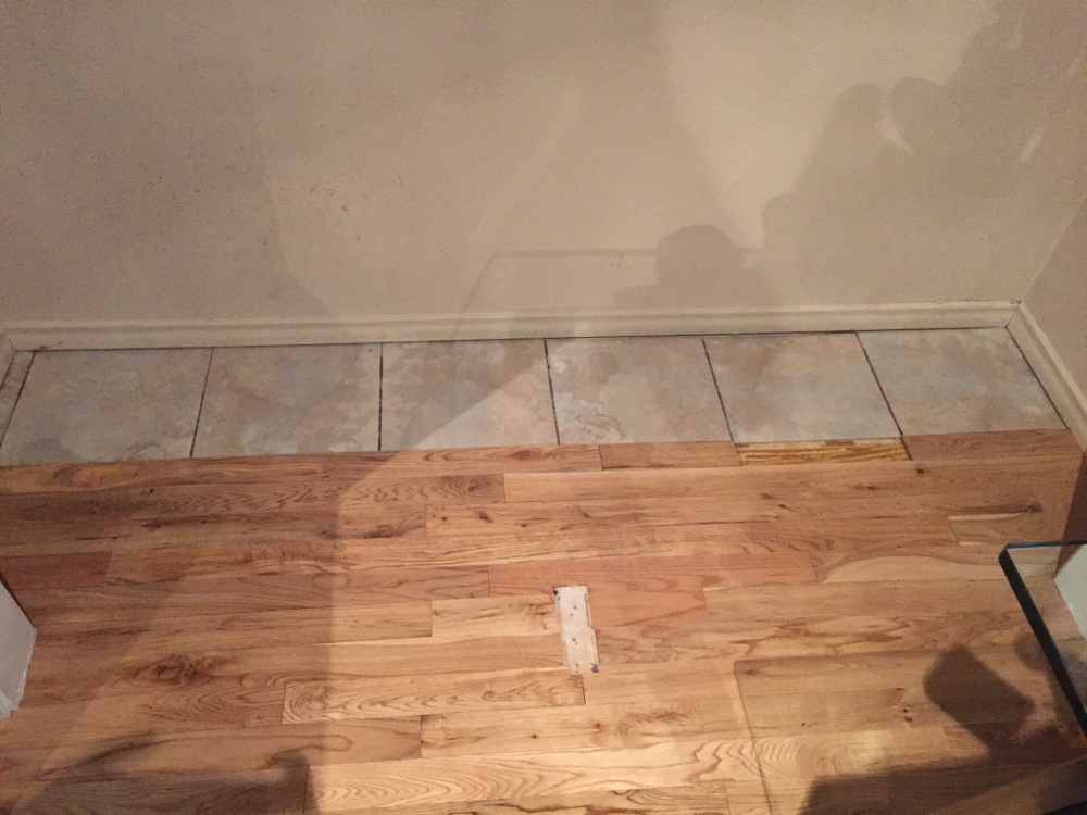 Half a Wood Floor and Half Vinyl Stick-Em Tile