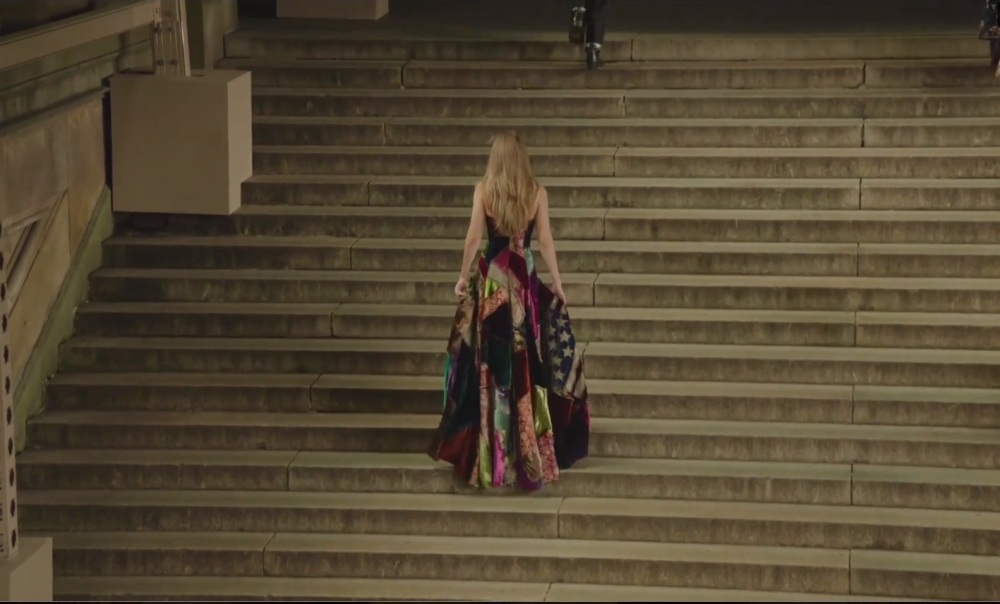 Gigi Retreating up the Stairs