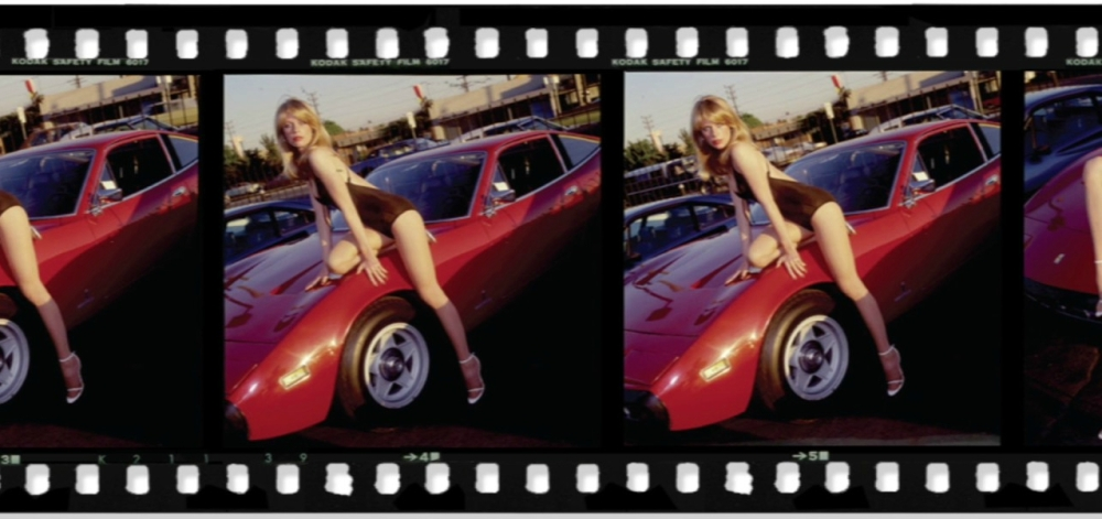 Candy Posing on the Ferrari