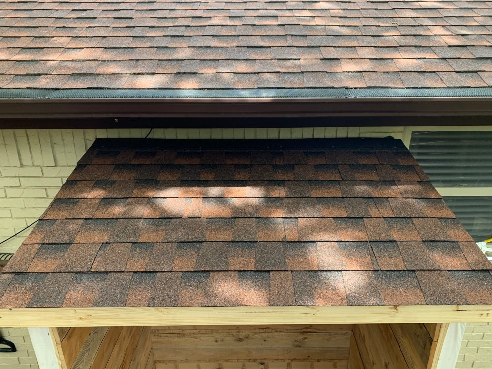 New Roof of Tool Shed with Unused Shingles